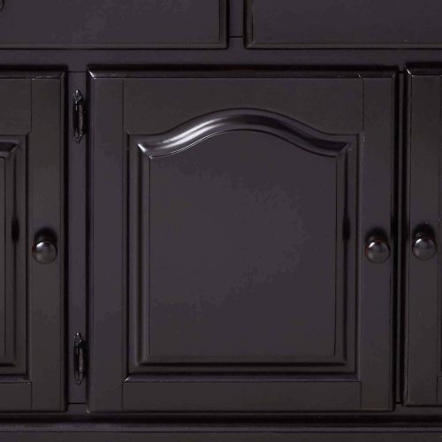 Black Cherry Selections - Treasure buffet and lighted hutch in Antique black finish with Cherry accents - detail of buffet door DLU-22-BH-BCH